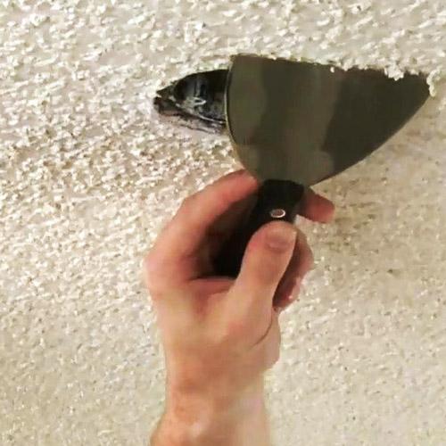 como quitar el gotele de paredes y techos